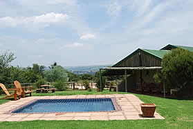 Stone Hill Self Catering Accommodation in Magaliesburg with timber cottages
